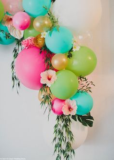 17 Fun Ways to Bring the Balloon Wall Trend to Your Next Party Such a beautiful way to incorporate bright colored balloons, flowers and greenery. Would be awesome decor at a Hawaiian Luau themed Baby Shower Luau Baby Showers, Luau Bridal Shower, Shower Party, Bridal Showers, Hawaian Party, Hawaiian Birthday, Hawaiian Luau Party, Hawaii Birthday Party, Hawaiian Baby