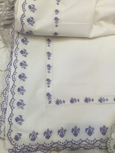 Holliday backup linens from Schweitzer....machine embroidery. Edging has more movement than what you are seeing