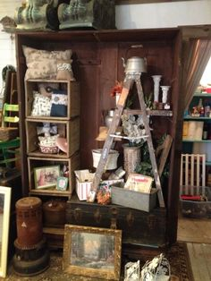 LOVE old ladders as displays for my shop!! www.favebook.com/SACscreativeaspects