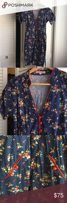 Trollied Dolly Rockabilly Dress Darling 100% cotton, vintage-style dress with red buttons. Excellent condition. Rouches on the sleeves.  Ties in back. Perfect for your weekend picnic or hootenanny! ModCloth Dresses Midi