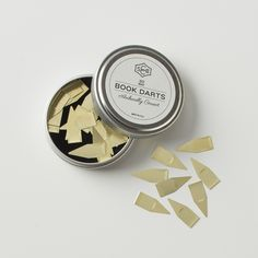 Help keep your books in tip-top shape with these thin, reusable book darts. Made of paper-thin brass, these darts slide easily onto any page so you can mark a passage or save your spot. Darts are packaged in a reusable tin. A Schoolhouse Exclusive.