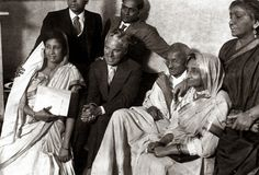 September 22,1931-Mahtma Gandhi meets Charlie Chaplin in Canning Town, London with Sarojini Naidu standing on right