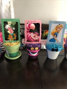 Alice in wonderland inspired, table centerpieces hand painted flower pots.