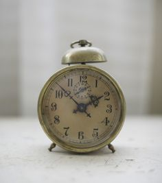 vintage alarm clock, $75 on #Etsy. Love the patina and the delicate hands, and the numbers. Swoon.