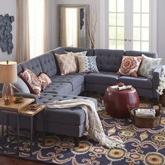 Hand-tufted and upholstered in a neutral poly/linen blend, our Nyle sectional has a modern, streamlined silhouette with tapered wood legs and loose cushions, and can be configured countless different ways.  I like the color scheme.