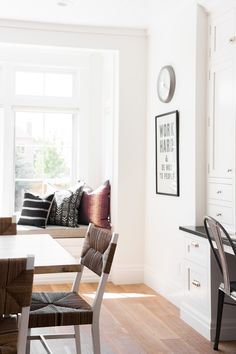 Kitchen nook with window seat and workstation || Studio McGee