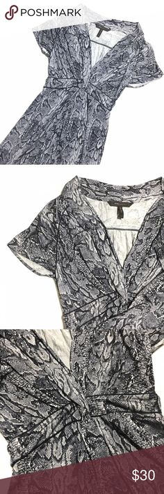 Snake print dress   BCBGMAXAZRIA Beautiful snake print dress! V cleavage, small twisting, and about 23 inches from waist to end of dress. BCBGMaxAzria Dresses