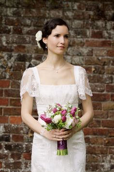 This simple updo, with the little waves, might work nicely with my dress, which is similar in many ways to the one in this picture (sheer cap sleeves, lacy bodice...)