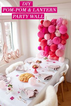 DIY Party Wall   Pom-Poms and Paper Lanterns make quite the statement wall!