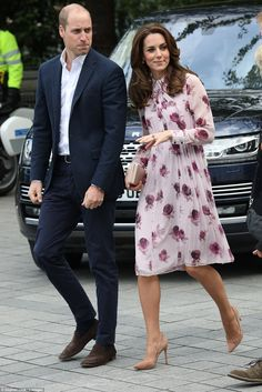 The Duchess of Cambridge looked surprisingly summery today in a pink rose print dress for ...