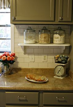 Use a small shelf to have things accessible but up off the cabinet. Love!
