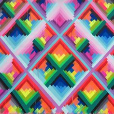 Try something with this - layers of blocked color, symmetry but imperfect...