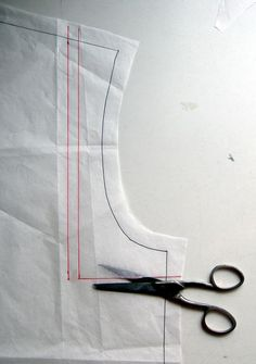 2 Mark shoulder reduction. Draw a second line parallel to the first. The distance between them is the amount you want to reduce the shoulder seam. Cut along the first line