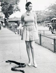 A burlesque dancer named Zorita walks her pet snake in the 1930′s.