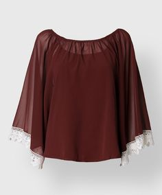 This chiffon blouse is perfect for fall layering. The long bell sleeves are finished with crocheted lace.