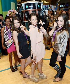 Fierce Five gold medal gymnasts Kyla Ross, Gabby Douglas, McKayla Maroney, Aly Raisman and Jordyn Wieber rang the closing bell at the New York Stock Exchange in NYC Aug. 14.