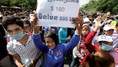 Workers demand higher wages during a protest outside the Ministry of Labour in late December