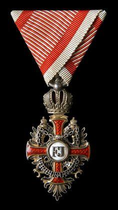 Franz Joseph Order, Knight's Cross badge, mounted on military ribbon. 01