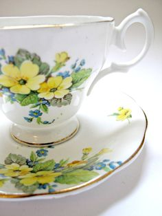 Vintage Bone China Tea Cup and Saucer with Pretty Yellow Floral Pattern.