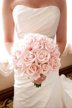 A bouquet of full pink roses is a classically chic choice. Wedding Flowers, Bouquets