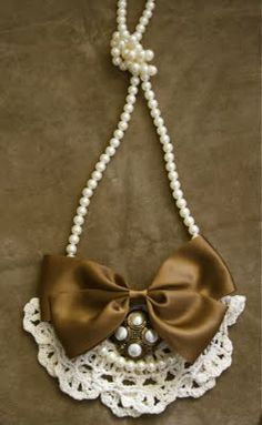 Instead of a necklace, I want to sew the pearls down to a v-neck and the lace