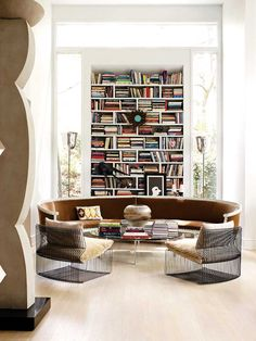 Modern living room in Atlanta by John Oetgen with curved sofa on Thou Swell @thouswellblog