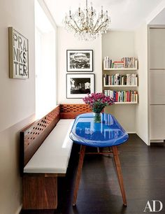 A Christopher Wool artwork presides over a Manhattan breakfast area. The wood banquette and striking table were designed by Francis D'Haene.