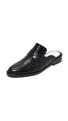 f637ccc43f6e Glossy, croc-embossed leather adds sophisticated style to these Freda  Salvador mules.