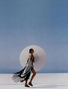 Twirl away your Monday blues. Harper's BAZAAR, 1992. Photograph by Patrick Demarchelier, Model Claudia Mason