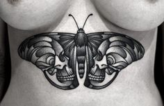 Gorgeous dotwork skull butterfly by Kamil Czapiga.