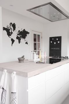 Black and white Scandinavian kitchen with a modern look that still has its own playful personality and charm.