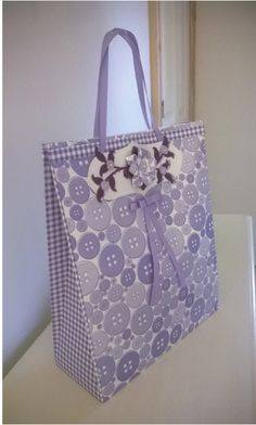 Gift Bag:  Lilac buttons and gingham A4 Card have been used to make this feminine gift bag, which has been embellished with cold porcelain flowers and Spellbinders die cuts.