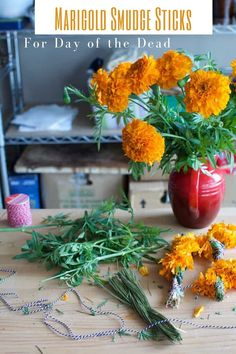 Making your own smudge sticks are way easier than you might think. In just two easy steps you can create homemade smudge sticks using any flower or herb. Smudge sticks are used to clear negative energy in the home and purify your living space. Simply tie the herbs and flowers together, let dry for 2 weeks, then they're ready to burn. | ¡Hola! Jalapeño | DIY Smudge Sticks | www.holajalapeno.com #smudgesticks #marigold #DIY #dayofthedead