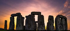 Winter Solstice 2016 | Sun shines through the stones at Stonehenge. Over five thousand early risers celebrated Winter Solstice at Stonehenge on 21 December 2016. Stonehenge attracts many visitors during the solstice who hope to catch a glimpse of the iconic sunrise above the stones. The solstice symbolises the changing of the seasons and is derived from two Latin words 'sol' (sun) and 'sistere' (to cause to stand still).