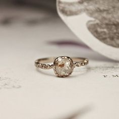 love the unfinished look of this ring... beautiful - Opaque Diamond Ring from Rust Jewelry.