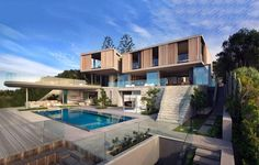 Hovering over a dune is this contemporary beach house designed by SAOTA Architects, located just steps from the snow white sands of Robberg Beach in Plettenberg Bay, South Africa. The design of thi… Luxury Swimming Pools, Luxury Pools, Swimming Pool Designs, Indoor Swimming, Style At Home, Home Luxury, Luxury Houses, Luxury Lifestyle, Contemporary Beach House