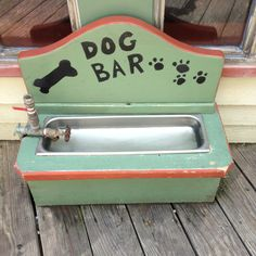 A doggy watering fountain outside a restaurant .. How cute