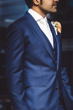Royal blue suit and white tie with peach buttonhole | Caveira Photography | See more: http://theweddingplaybook.com/industrial-art-gallery-wedding/
