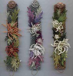 crafty jewelry: beaded flowers. | make handmade, crochet, craft  link has an example of artist beaded flower... beautiful.  Artist: Margo