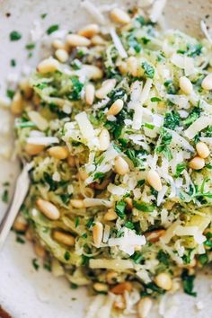 Garlic Spaghetti Squash with Herbs + pine nuts and Gruyère cheese. 300 calories. | pinchofyum.com #squash #vegetarian #recipe