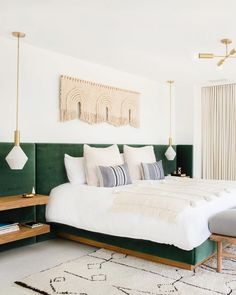 Mandy Moore's bedroom is what we all dream of, with its green upholstered headboard and macrame wall hanging and blanket. Photo: Tessa Neustadt Design: Sarah Sherman Samuel
