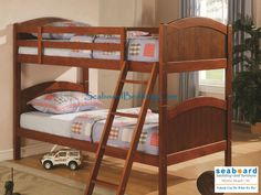 Designed to save space, this twin over twin bunk bed is a perfect solution for your children's bedroom. Constructed of solid pine in a dark pine finish, this piece offers durability and a relaxed style. Full length guard rails provide safety, while the included ladder allows for easy access to the top bunk. Whether your children share a room or they just want a fun and unique look, this bed will make a wonderful addition to their space!