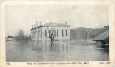 In 1937 there was a tremendous flood of the Ohio River.  In affected a lot of cities and town.  Among them was Jeffersonville, Indiana, pictured here with flood waters drowning the town.  The water level is shown dramatically as nearly covering the first floor of the old city hall building.