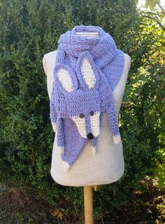 """Lavender blue fox, handmade soft scarf, crochet wrap, very long animal scarf, blue fox, fox scarf, lavender violet white, shawl  Soft and nice blue fox — made by me, made of soft lavender and white yarn, with buttons eyes and embroidered nose.  Length with paws and tail: 85 (216 cm), without paws and tail (only """"body""""): 60 (154 cm) Width: 9 (23 cm)   Made in a smoke free house.  Ready to ship.   Please check dimensions carefully. Due to lighting conditions and monitor settings, colors may…"""