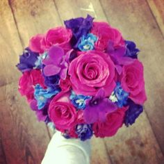 Wedding Bouquet- purple lisianthus, fuchsia dendrobium orchids,  hybrid blue delphinium, and hot pink roses..