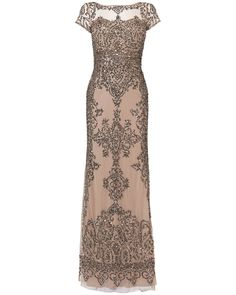 From Collection 8 - a range of beautiful limited edition evening dresses. An all over sequin embellished dress with sheer neckline and sheer cap sleeves. Styled with a sweetheart neckline lining and low scoop back. Fully lined and fastens with a concealed centre back zip.