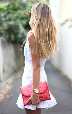white dress, colorful clutch.
