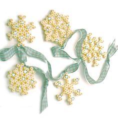 <p>Make this beautiful set of sparkling snowflake ornaments with Perler Beads! These pretty lacy patterns will look great on a tree or use the smaller ones to create a garland. They also make great package ties!</p>