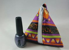 Check out this item in my Etsy shop https://www.etsy.com/listing/477370445/trick-od-treat-triangle-polish