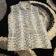 Snakeskin shirt listed 3/6 Beautiful blouse, effortless fit.. button front..small slits on the side , sleeveless and to die for ...in excellent preloved condition, pair with shorts, tuck in or leave it out of some pants, loose fit so will also fit a size XL..Vintage Marla Kim Tops Button Down Shirts